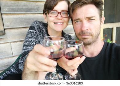 couple wine selfie farmstay holiday tasmania
