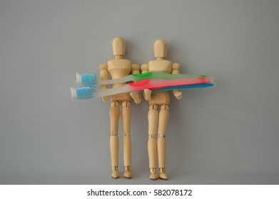 Couple of Wood Figures Model Manikin Mannequin Human Dummy Holding Toothbrushes Isolated on Lay White Center Position