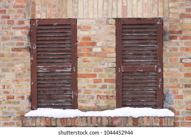 A Couple of wooden window with snow (Pesaro, Italy)