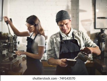 Couple working in a coffee shop
