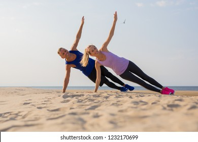 Couple working out by the sea
