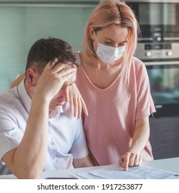 couple worried about unpaid bank debt calculate bills, shocked poor family looking at calculator counting loan payment upset about money problem during the pandemic coronavirus,