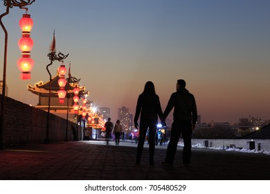Couple at Xian City Wall. It is the largest ancient military defensive systems in the world located at Xian ,China