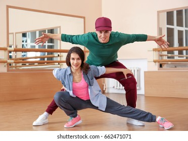 Couple of young hip-hop dancers in studio