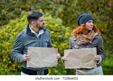 couple of young hipsters holding craft  paper sheet with copy space. Place for inscription.relationship problem,body language,Codependent Relationship
