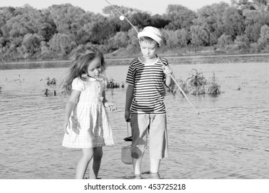 couple,boy and girl on the river summer day.Black and white photo stylized vintage style