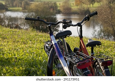 a couples bikes on a lake