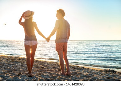 Couples during sunrise at the beach