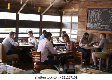 Couples enjoying lunch at a busy restaurant