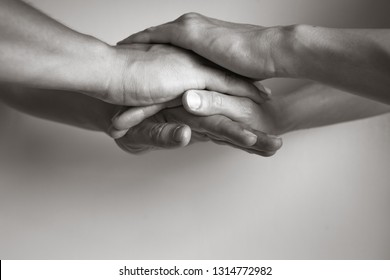 Couples hands coming together. In Unity there is strength concept.