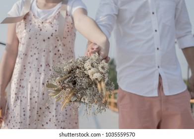 Couples holding the flowers together, show your love towards each other soft focus.