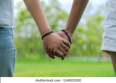 Couples holding hands in beautiful park