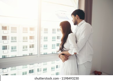 couples lover Laying On Bed Happiness Lifestyle and smiling girl relaxing in white bed