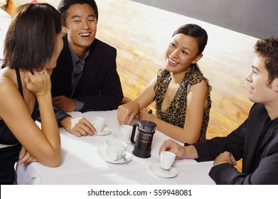 Couples sitting in restaurant, having coffee
