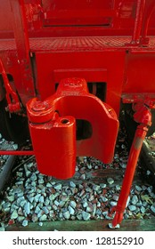 A coupling on a caboose painted bright red