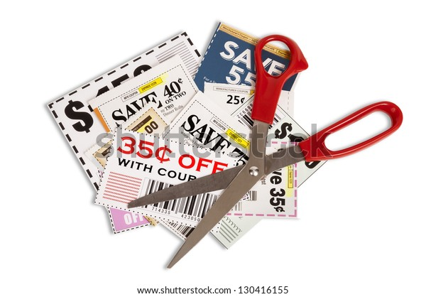 Coupons With Red Handled Scissors Isolated On White  Close Up Please note...coupons showing are not real. They are fake.  There is no copyright.
