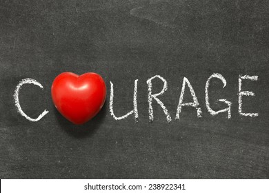 courage word handwritten on  chalkboard with heart symbol instead of O