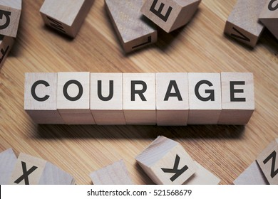 Courage Word Written In Wooden Cube