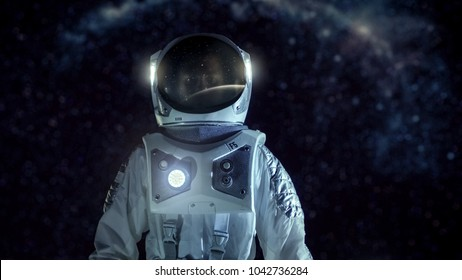 Courageous Astronaut in the Space Suit Stands on the Alien Planet. Milky Way Galaxy Behind Him. Exploring Newly Discovered Planet. Space Travel and Extraterrestrial Colonization Concept.