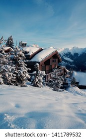 Courchevel 1850m looking over a chalet and the mountain in winter
