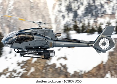 Courchevel Altiport, France - February 24th 2018. Black Eurocopter EC-130B-4 F-DRY Heli Securite - Helicopter Airline land at the heliport over the Alps to take and bring rich people and skiers.