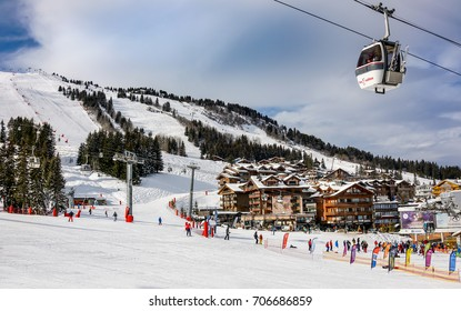 COURCHEVEL, FRANCE - JANUARY 21, 2017 : View of slopes and hotels in  winter ski resort Courchevel 1850m, France. Les 3 vallees is the world largest ski area.