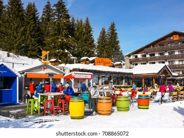 COURCHEVEL, FRANCE - JANUARY 24, 2017 : Outdoor bars for apres ski over the slopes of winter ski resort Courchevel, France.