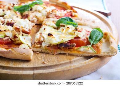 Courgette, chicken and feta pizza on board
