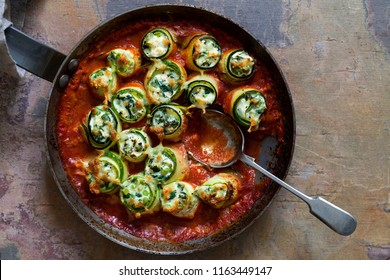 Courgette stuffed with ricotta, spinach and peas in tomato sauce