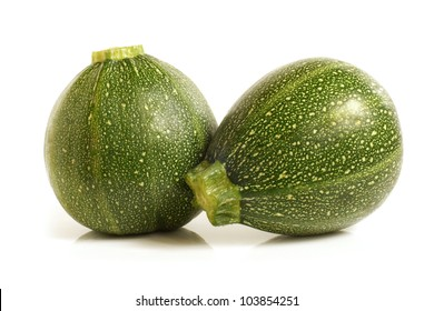 Courgette or zucchini on a white background