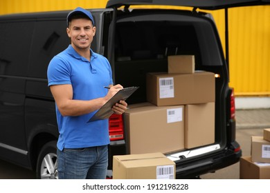 Courier with clipboard near delivery van outdoors