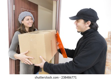 Courier Delivering a Package to a happy woman