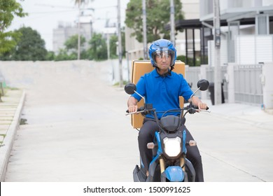 Courier delivering parcel box by motorcycle or scooter. Fast express transport delivery concept