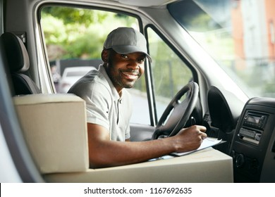 Courier Delivery. Black Man Driver Driving Delivery Car