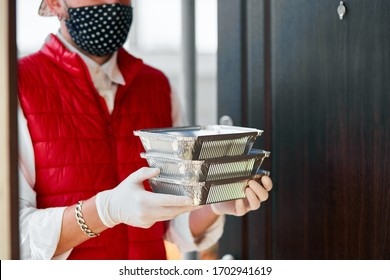 Courier hold go box food, delivery service, Takeaway restaurants food delivery to home door. Stay at home safe lives from coronavirus COVID-19 outbreak. Delivery service under quarantine.