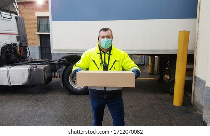 courier man delivery a box during Coronavirus Pandemia with gloves and medical mask