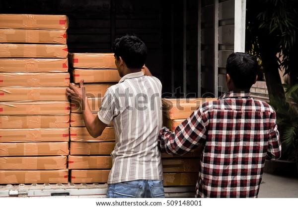Courier Man Loading Materials Small Truck Stock Photo (Edit Now
