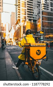 Courier on bicycle Delivering food in city take a way food