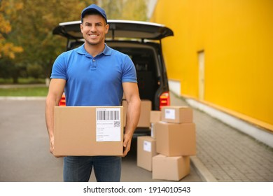 Courier with parcel near delivery van outdoors. Space for text