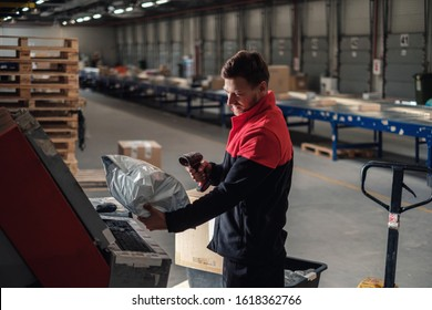 Courier picks up package on a warehouse