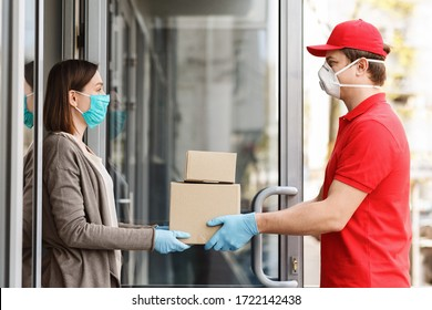Courier in protective mask delivers packages to door. Girl picks up boxes - Shutterstock ID 1722142438
