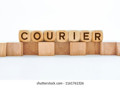 Courier word on wooden cubes