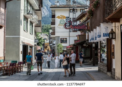 Courmayeur, Aosta, Italy - 14 July 2018: a general view of the picturesque main shopping street with people strolling