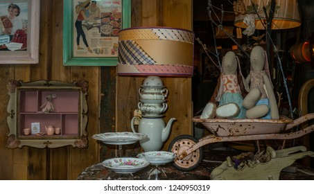 Courmayeur, Aosta Valley, Italy - August 7, 2018: Decorative and vintage objects exposed in a shop window.