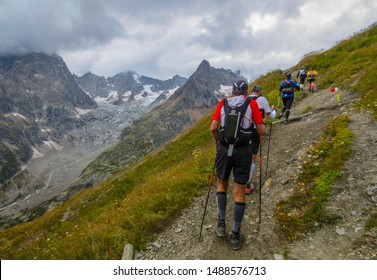 Courmayeur, Aosta Valley / Italy - August 29 2014: Runners on a trail during the UTMB CCC ultra marathon around Mont Blanc