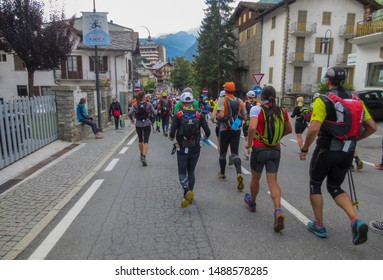 Courmayeur, Aosta Valley / Italy - August 29 2014: Runners running through the streets of Courmayeur during the spectacular UTMB CCC 100 kilometer ultra marathon around Mont Blanc