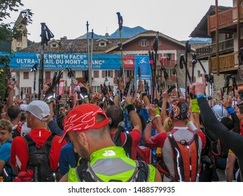 Courmayeur, Aosta Valley / Italy - August 29 2014: Runners at the start of the spectacular UTMB CCC 100 kilometer ultra marathon around Mont Blanc