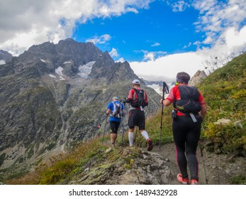 Courmayeur, Aosta Valley / Italy - August 29 2014: Runners on a trail during the spectacular UTMB CCC ultra marathon around Mont Blanc
