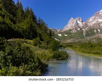 Courmayeur, Aosta Valley, Italy - Mont Blanc Massif. Combal lake and plateau, between Italy and France. In the background: Pyramides Calcaires.