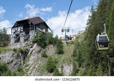 Courmayeur, Italy - July 15, 2018: Mont Blanc cable car in the Italian Alps arriving at the station on a summer day